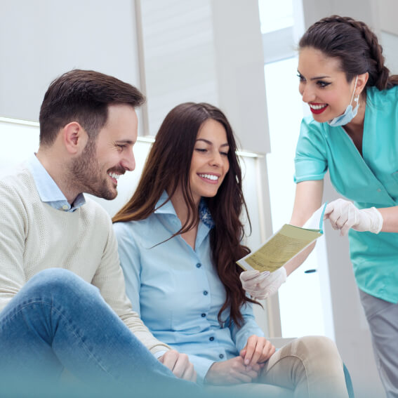 a couple being shown their options for dental work payment